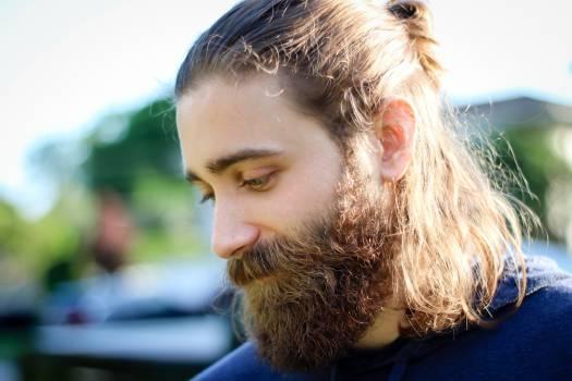 Man With Brown Beard Facing Downwards during Daytime #38629