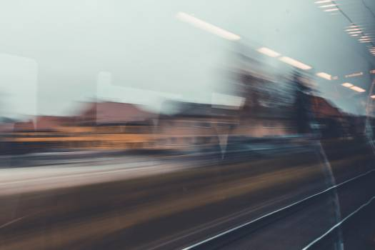 Long exposure photo of a train passing through the city #386321