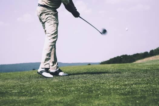 Golfer at a golfcourse Free Photo