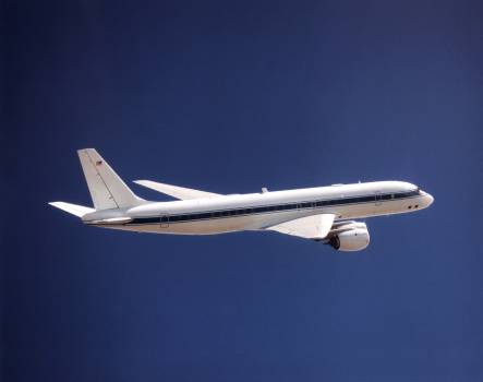 NASA's DC-8 Airborne Science platform shown against a background of a dark blue sky on February 20, 1998. Original from NASA .  #386952