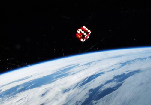 A dice floating in front of one of the windows in the Cupola of the Earth-orbiting International Space Station. Original from NASA.  #386996