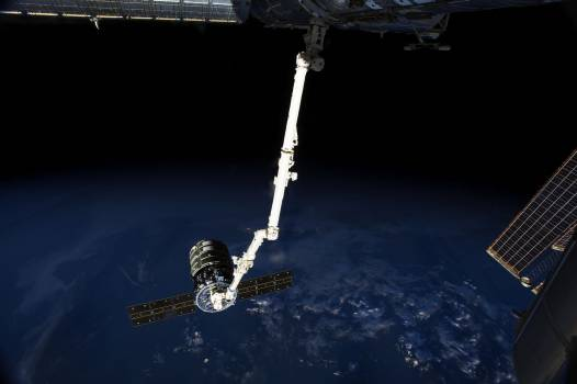 The International Space Station's Canadarm2 prepares to release the Orbital Sciences' Cygnus commercial cargo craft after a month visiting the orbital outpost. Original from NASA .  #386997