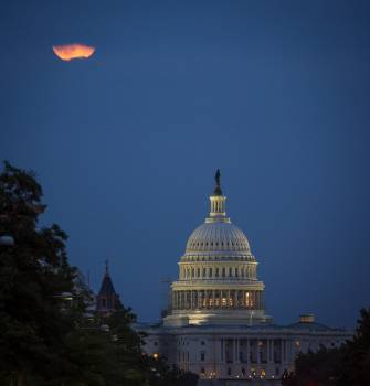 A perigee full moon or supermoon is seen behind clouds over the United States Capitol, Sunday, August 10, 2014, in Washington. Original from NASA.  #387008