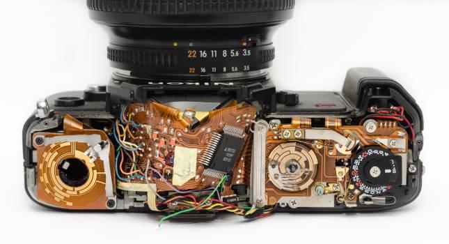 Black Dslr Camera Showing Its Circuit Board Free Photo
