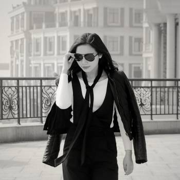 Greyscale Photo of Woman Wearing Sunglasses Long Sleeves Shirt and Skirt during Daytime Free Photo