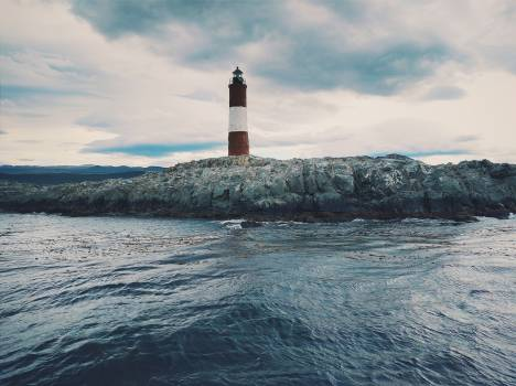 Red and White Lighthouse Free Photo