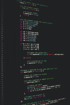 Software developer programming code on black background #388196