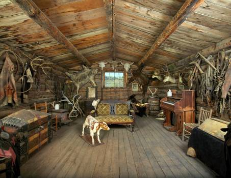 Interior of one of the original old cabins moved to this location at the Old Trail Town living-history museum in Cody, Wyoming. Note an unusual but not unprecedented decoration in the room: a stuffed, two-headed calf. Original image from Carol M. Highsmit Free Photo