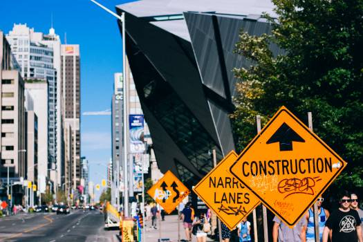 Yellow and Black Street Signs on the the Side of the Road during Daytime #39063