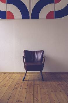 Brown leather armchair in a room #390825