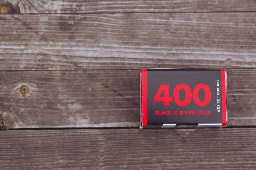 ISO 400 film roll on a wooden table Free Photo