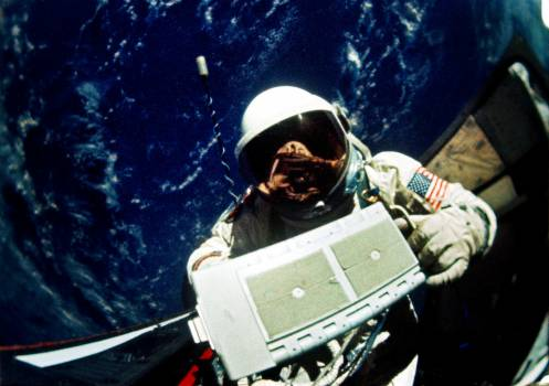 Astronaut Edwin E. Aldrin Jr., pilot for the Gemini-12 spaceflight, removes micrometeoroid package for return to the spacecraft during extravehicular activity (EVA). Original from NASA .  Free Photo