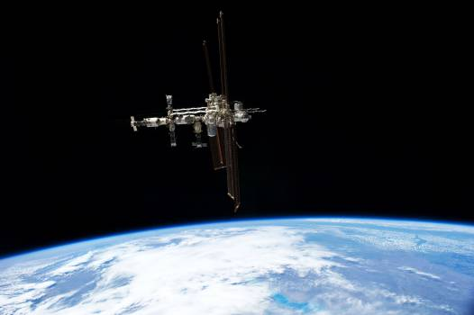 This picture of the International Space Station was photographed from the space shuttle Atlantis in the early hours of July 19, 2011. Original from NASA .  #392652