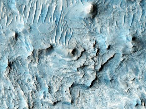 Ius Chasma is one of several canyons that make up Valles Marineris, the largest canyon system in the Solar System. Original from NASA .  #392743