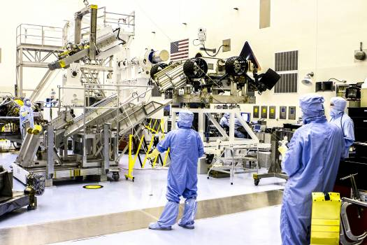Spacecraft technicians from NASA's Jet Propulsion Laboratory position the multi-mission radioisotope thermoelectric generator (MMRTG) for NASA's Mars Science Laboratory (MSL) mission on the turning fixture above the MMRTG integration cart. Original from N #392852