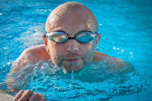 Man With Gray Swimming Goggles in Body of Water Free Photo