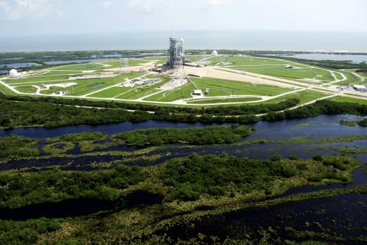This aerial view shows the high water surrounding Launch Pad 39A at NASA's Kennedy Space Center following Tropical Storm Fay. Original from NASA.  #392986
