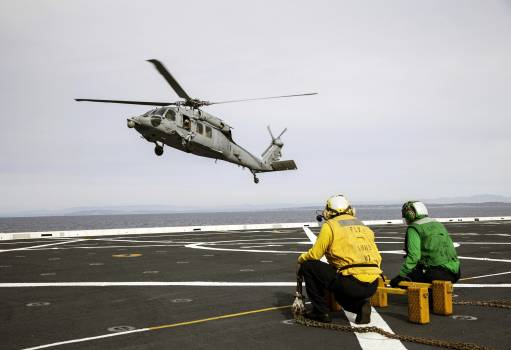 An H60-S Seahawk helicopter lands on the deck of the USS Anchorage in the Pacific Ocean off the coast of California. Original from NASA.  Free Photo
