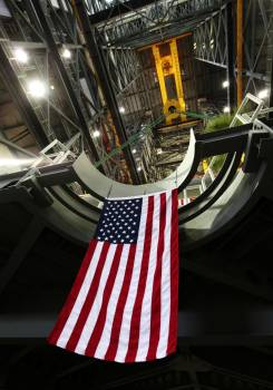 The American flag can be seen hanging from the final work platform, A north, as the platform is lifted up by crane from the transfer aisle in the Vehicle Assembly Building (VAB) at NASA's Kennedy Space Center in Florida. Original from NASA.  #393268