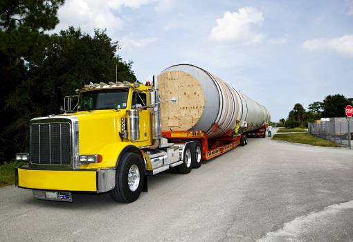 A space shuttle solid rocket booster has been loaded on to trucks for transport to California. Original from NASA.  #393295