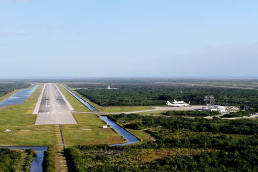 This is an aerial view of the long Shuttle Landing Facility SLF runway at NASA's Kennedy Space Center in Florida. Original from NASA .  Free Photo