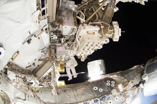 Astronauts working outside the space station's Quest airlock in Oct 7, 2014. Original from NASA .  #393305
