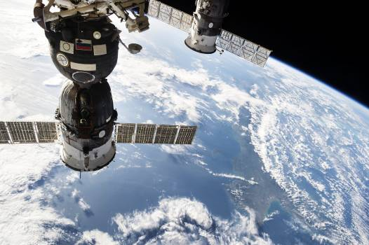 The Soyuz TMA-15M spacecraft on the left attached to the Rassvet module on the Earth-facing port of the Russian segment of the station Nov 24th, 2014. Original from NASA .  #393340