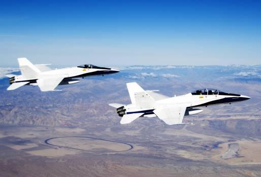 Two NASA F/A-18 #845 flying over the horizon. Original from NASA.  Free Photo