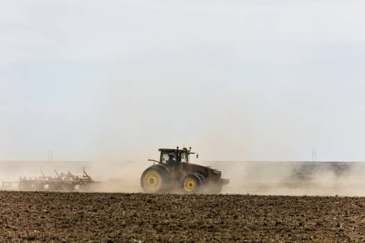 A farmer kicks up dust as he readies the ground for planting near Bristol in Prowers County, Colorado. Original image from Carol M. Highsmith's America, Library of Congress collection.  #393844