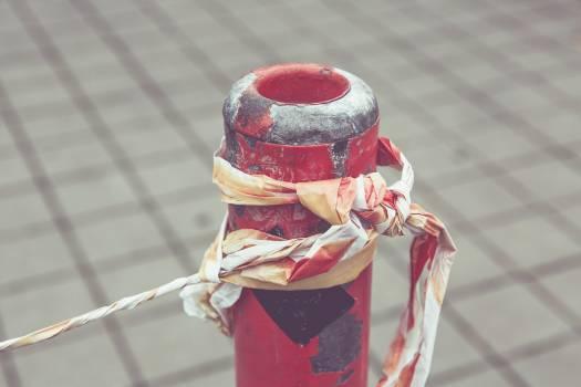 Warning tape around a pole Free Photo
