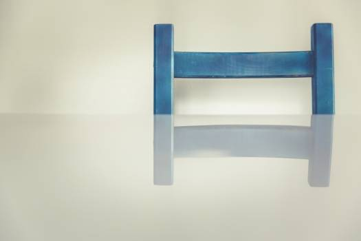 Blue chair by a table Free Photo