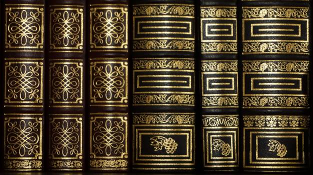 Black and Golden Stacked Book Free Photo