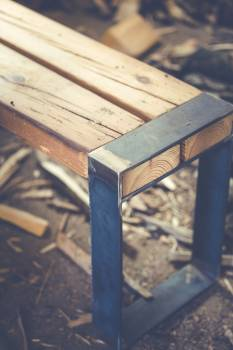 Wooden bench with a metal accent #394675