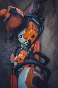 Orange chain saws on the floor #394801