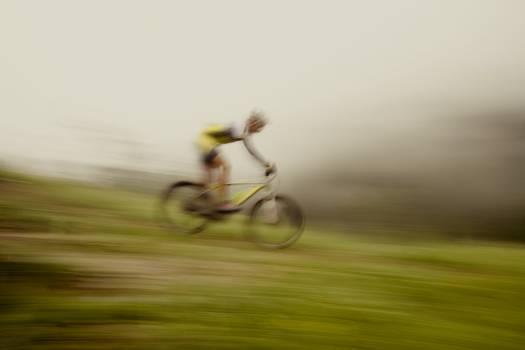 Mountain biker going downhill Free Photo