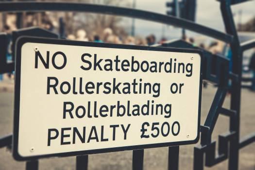 A sign forbidding skateboarding activity #395073