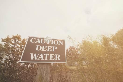 Caution deep water, warning sign Free Photo