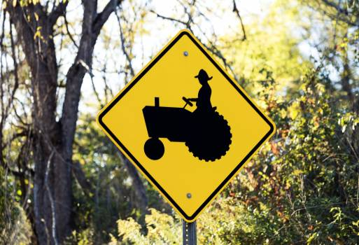 Road sign of slow moving tractor in Holmes County, Ohio. Original image from Carol M. Highsmith's America, Library of Congress collection.  Free Photo