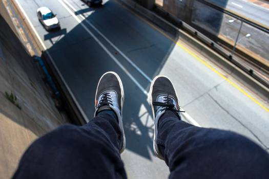 Man in Blue Pants Wearing Black and White Lace Up Low Top Sneakers #39614