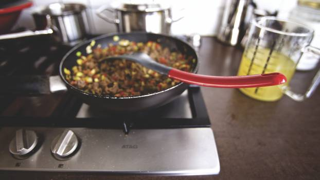 Dish Cooking on Black Non Stick Pan on a Burner #39858