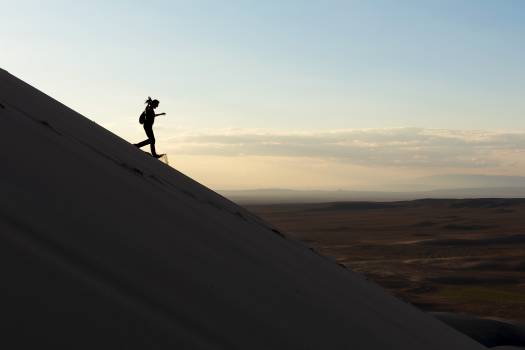 A woman runs down the sand dune - free stock photo #398766