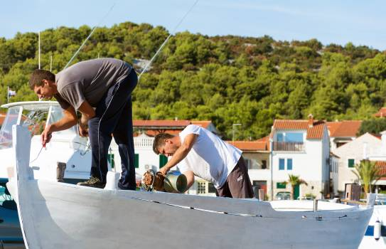 Two Workers Are Repairing a Boat - free stock photo #399184