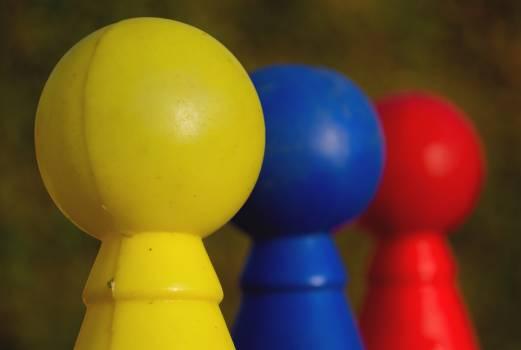 Three Colored Plastic Skittles - free stock photo Free Photo