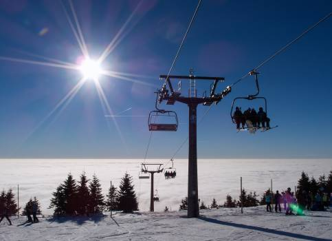 A chair lift at the top of a mountain on a sunny day - free stock photo #399388