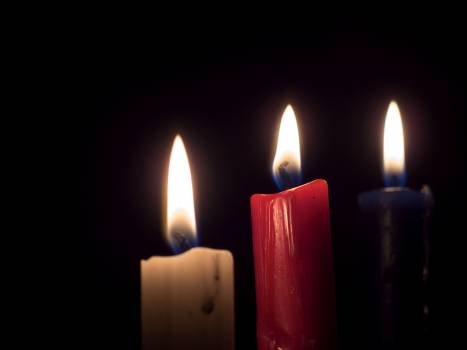 Three candles on a black background - free stock photo #399416