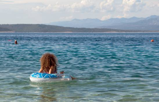 A Girl On Inflatable Ring In The Sea - free stock photo #399511