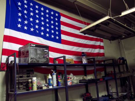 American Flag On The Wall Of Car Repair Shop - free stock photo #399721