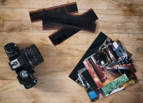 Camera Film And Photos On Wooden Background - free stock photo Free Photo