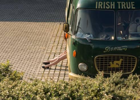 Irish bus and girl's leg - free stock photo #399929