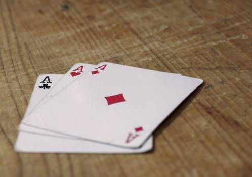 Three Aces Cards On Wooden Table - free stock photo #400030